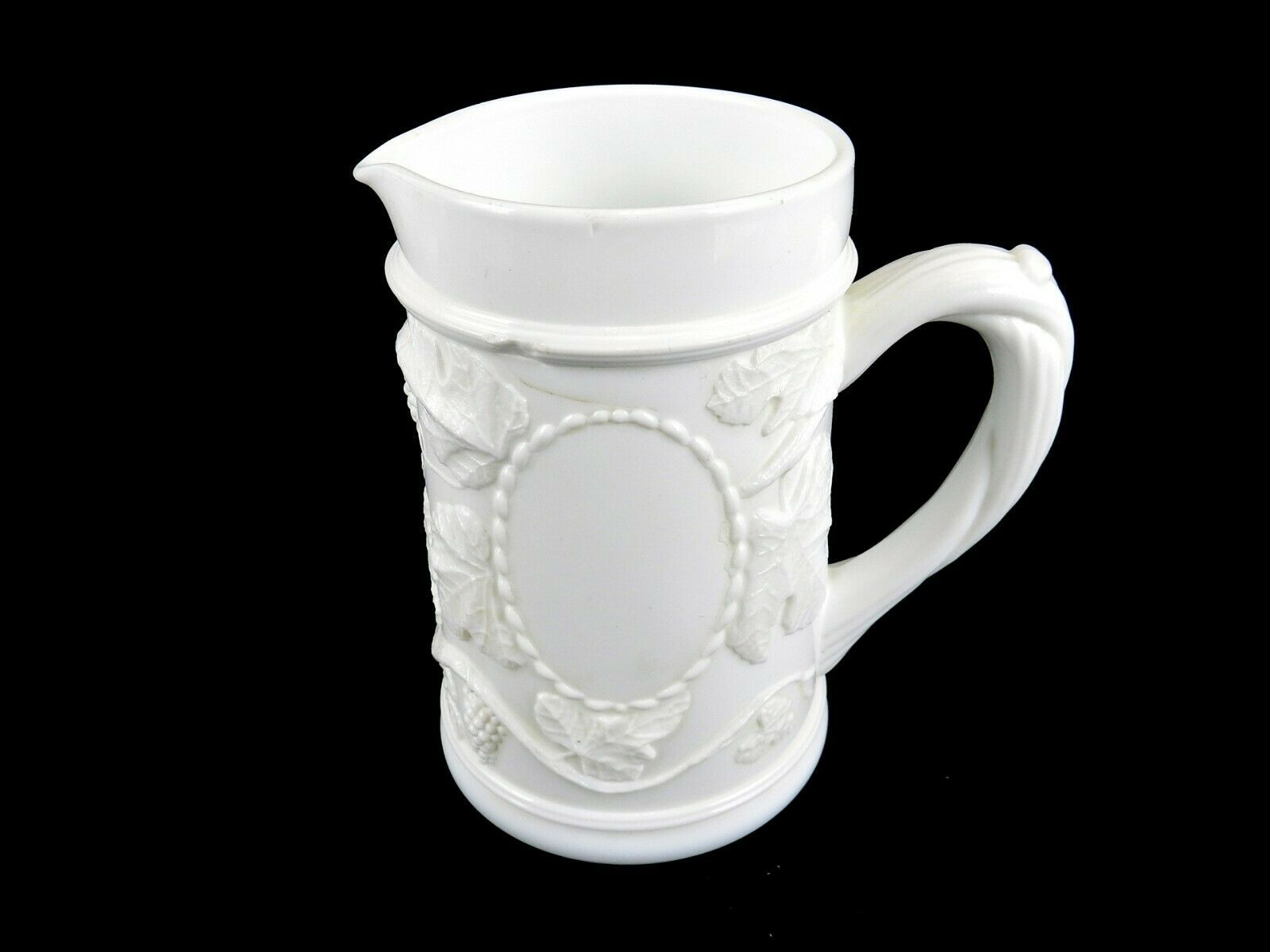 Primary image for Fenton Milk Glass Pitcher, Grapes & Leaves Bas Relief Pattern, Vine Handle