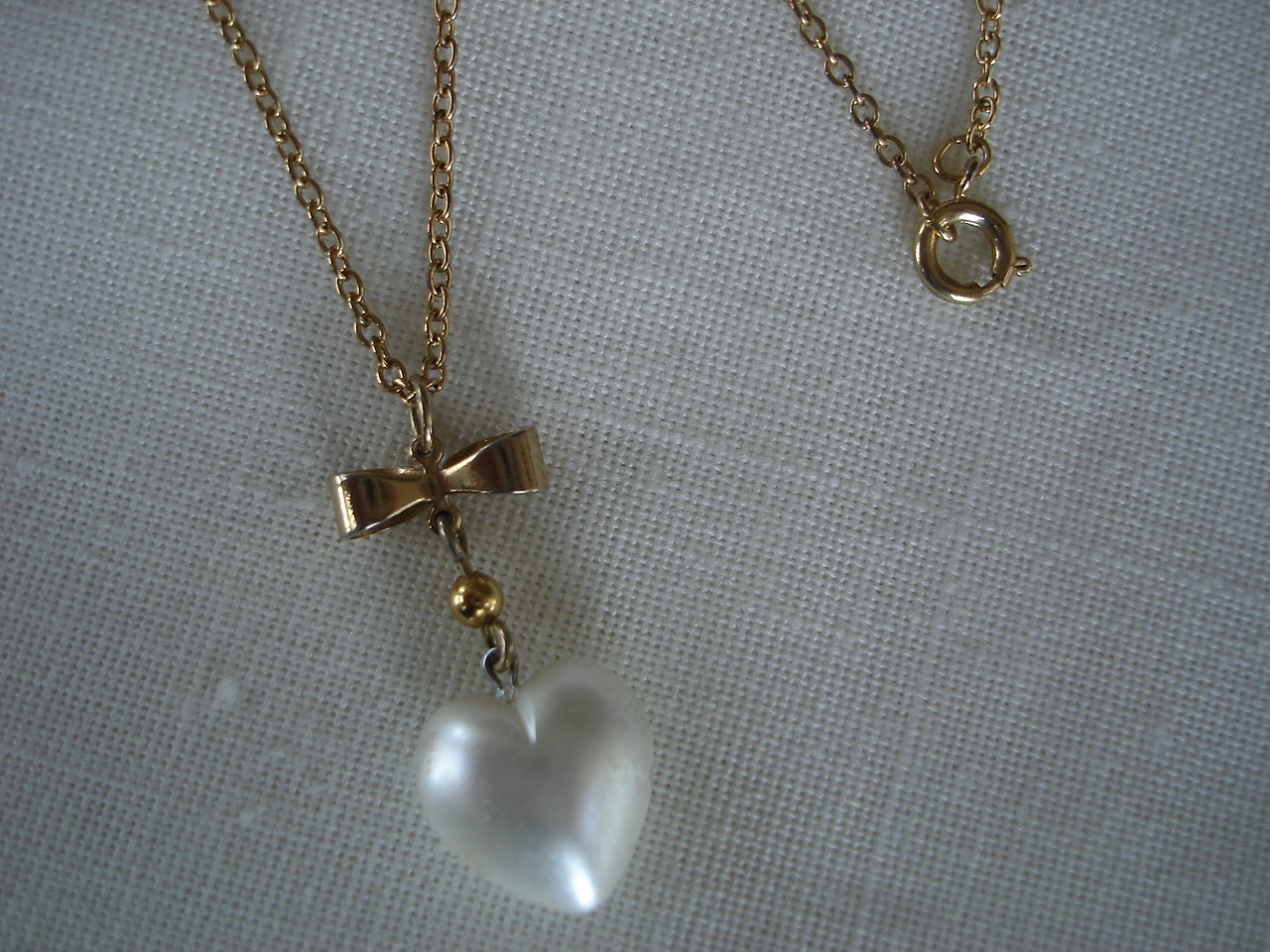 Simulated Pearl Heart, Goldtone Bow Pendant Necklace