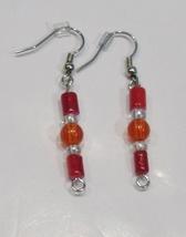handmade red & clear beaded drop earrings - $9.00