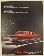 1965 Oldsmobile NINETY-EIGHT Red Print Ad ~ The Rocket Action Car! - $9.99