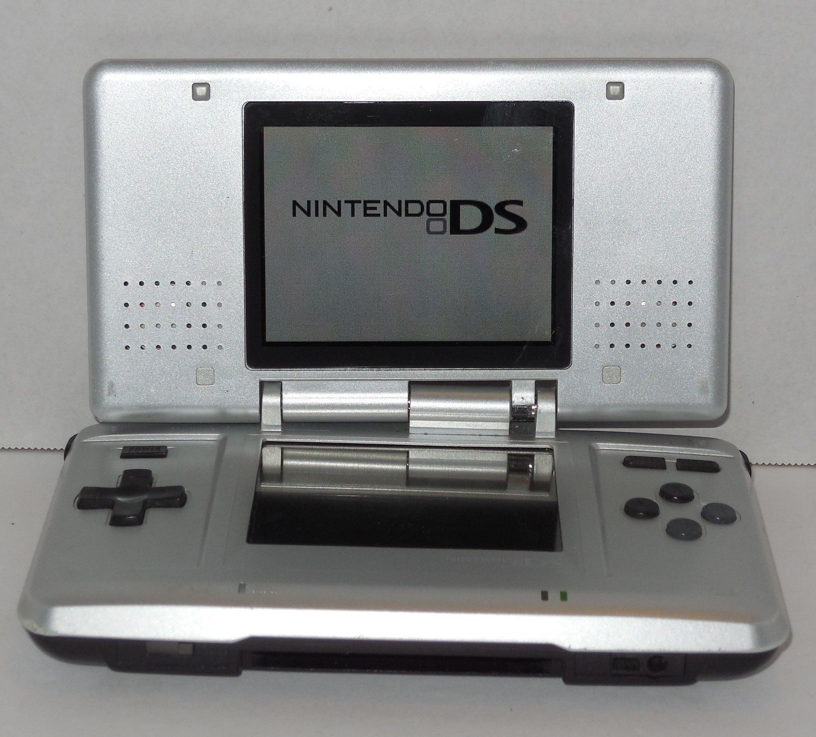 Primary image for Nintendo DS Silver Original Handheld Video Game Console Broken Hinge Still Works
