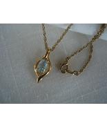 Goldtone Pendant Necklace, Aquamarine Crystal. Chain - $7.99