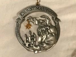 Christmas ornament pewter Avon 1997 Santa holding gold star over castle ... - $5.93