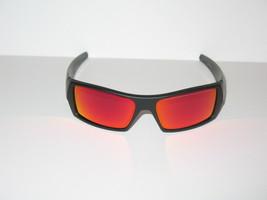 OAKLEY GASCAN MATTE BLACK FRAME W/ RUBY IRIDIUM LENSES - $128.70