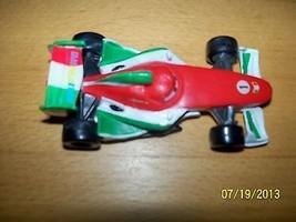 Disney Toy Pixar Cars World Grand Prix Racing Car red white green #1 - $9.89