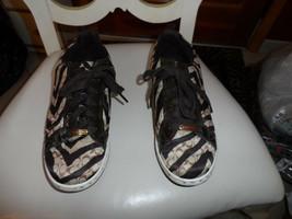 Ladies Coach brown and Tan Naya lace front zebra print sneaker size 8.5M - $30.00