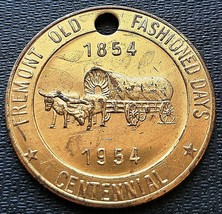 1954 Fremont Michigan 50 Cents Trade Token - Old Fashioned Days - Holed - $2.30