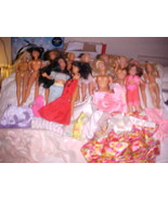 12 BARBIES LOT WITH CLOTHES - $39.99