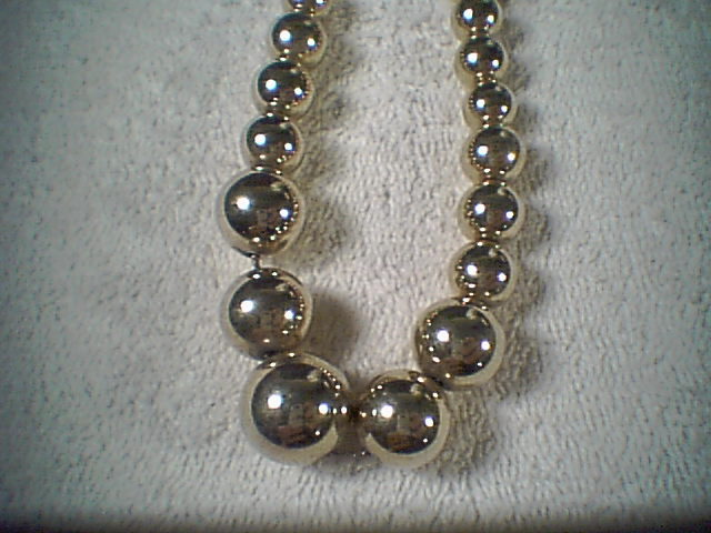 Gold tone beaded neckless