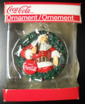 American Greetings Christmas Ornament 2010 Coca Cola Santa Red Disk Wrea... - $10.99