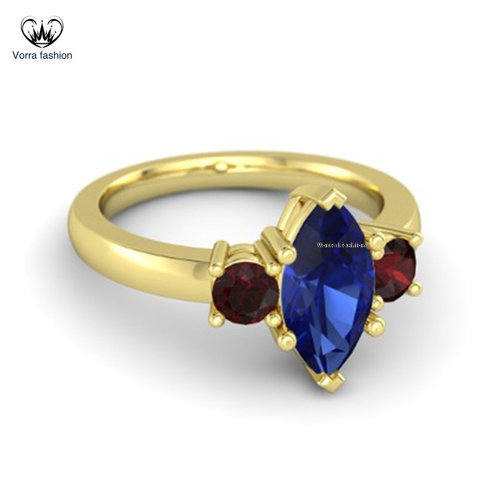 Marquise blue sapphire 18k yellow gold ring with red garnet