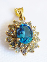 Classic 14kt Yellow Gold .68 CTTW Oval Blue Topaz & Round Diamonds Pendant - $1,188.00