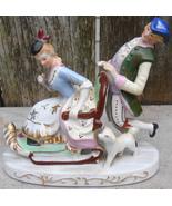Victorian Couple w Dog on Sleigh Porcelain Figure - $35.00