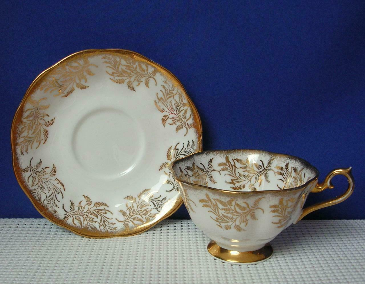 Primary image for Vintage ROYAL ALBERT Gold Feather Leaf Footed TEA CUP & SAUCER #4040 EUC