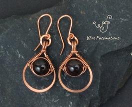 Handmade copper earrings: teardrop framed herringbone wire wrapped garnet - $33.00