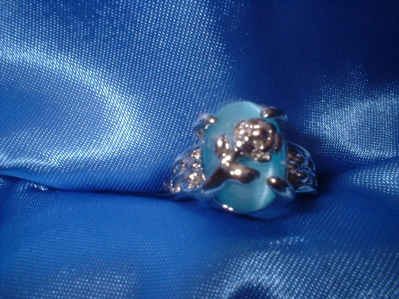 Flower aqua ring small stone
