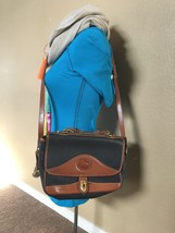 All Weather Leather Dooney and Bourke Vintage Bag - $75.00