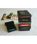Atari 2600 Lot of 7 Video Games Some Manuals Activision Pacman Football ... - $9.99