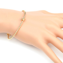UE- Stylish Gold Tone Designer Twisted Bangle Bracelet With Trendy Knot ... - $13.99