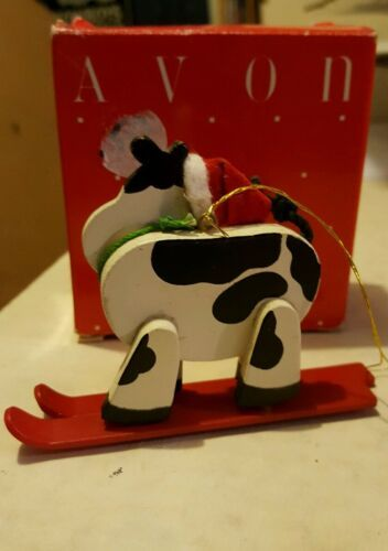 avon holly jolly cow ornament skiing cow