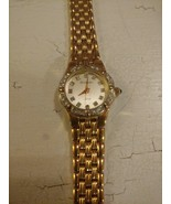Armitron Now Watch Mother Of Pearl Face Gold Dial Crystal Bezel Goldtone... - $19.75