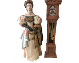 Lady standing next to grand father clock thumb155 crop