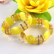 Fashion Cat's Eye Bead Stretch Bracelets Yellow color Crsytal Beads Accessory Br - $8.43