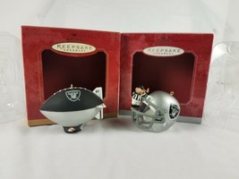 Hallmark Keepsake NFL Ornaments Set of 2 Santa in Blimp & Raiders Helmet - $16.78