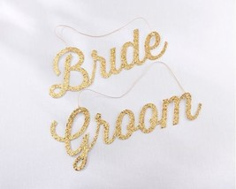Gold Glitter Bride and Groom Chair Signs - $18.76