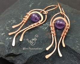 Handmade amethyst earrings: wire wrapped flowing curves - $30.00