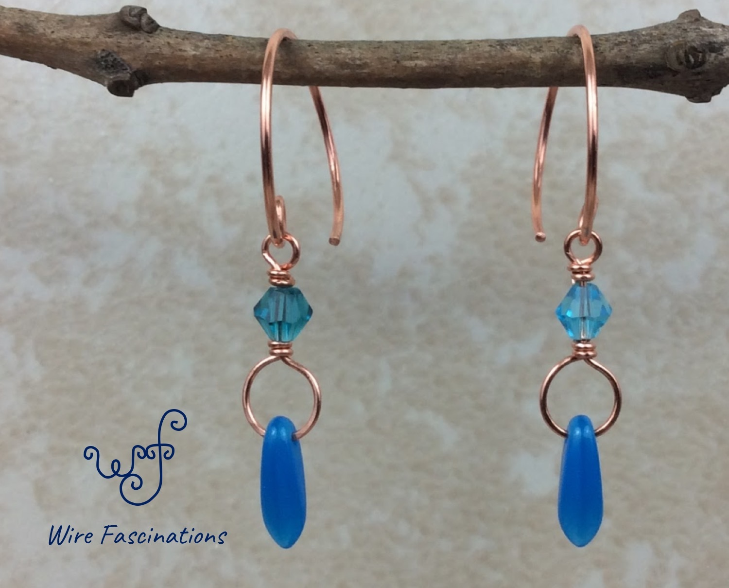 Handmade copper hoop earrings: wire wrapped blue crystal and dagger bead dangle