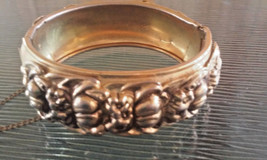 Vintage Signed Coro Pegasus Repousse Hinged Bangle Bracelet with Safety Chain - $33.25
