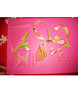 Vintage misc hair pieces and 2 hangers 5 thumbtall
