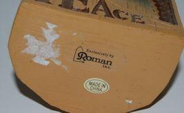 Roman Inc Peace Arch Snow Globe Kneeling Santa 8 Inches Tall image 6