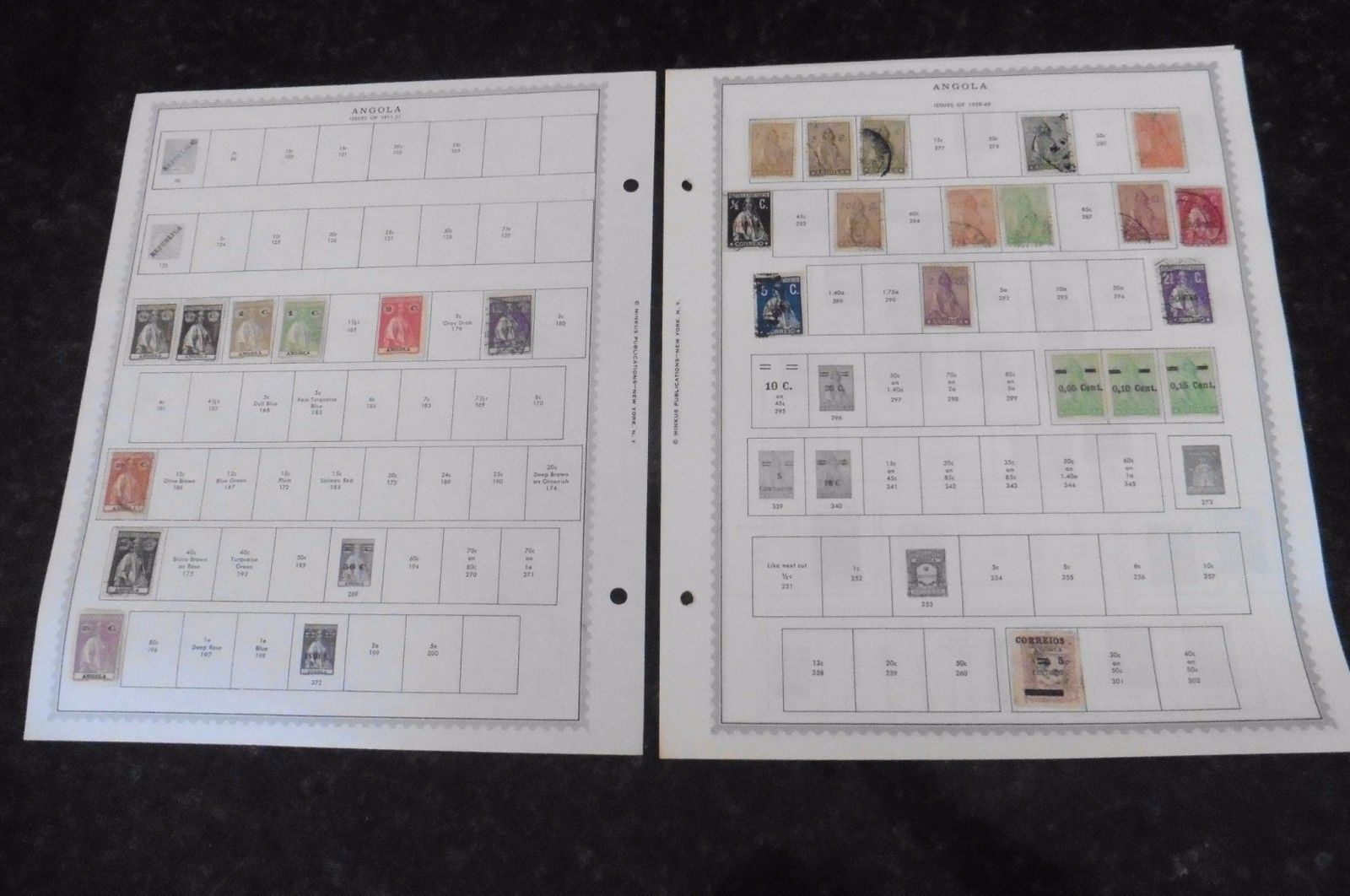 A55 Lot of Angola Stamps on 8 Minkus pages 1870-1970
