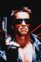 Arnold Schwarzenegger holding AMT Hardballer Longslide The Terminator 18x24 Post - $23.99