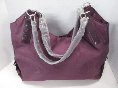 e3b0bc6b59 Calvin Klein Hobo Style PUrse with makeup accessory bag BRAND NEW!