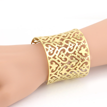 UNITED ELEGANCE Trendy Gold Tone Cuff Bracelet With Intricate Cut Out De... - $19.99