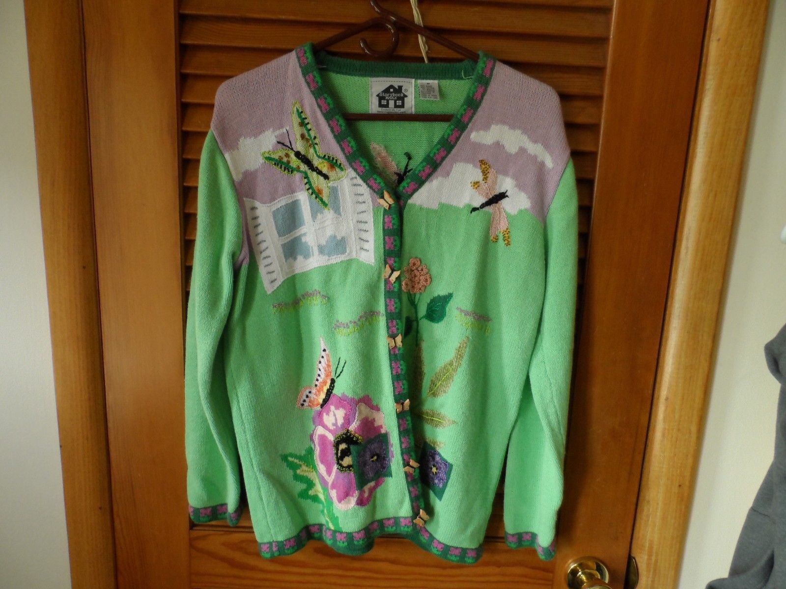 Green and pink cardigan from Storybook Knits size M with butterfly and dragonfly - $29.00