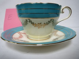 AYNSLEY TEA CUP AND SAUCER              E - $40.00