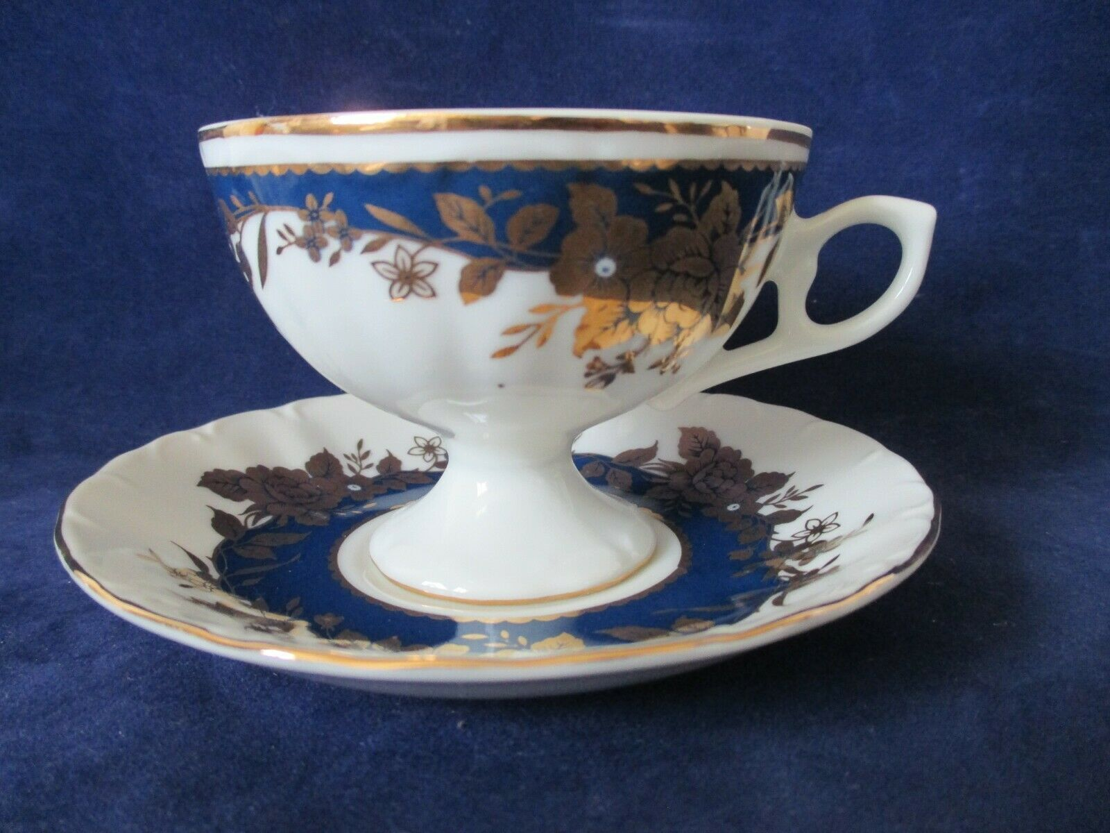 Primary image for Lefton China Footed Tea Cup Saucer 07685 Navy Blue Band Gold Roses 1990