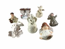 7 piece angel figurine collection - $24.74