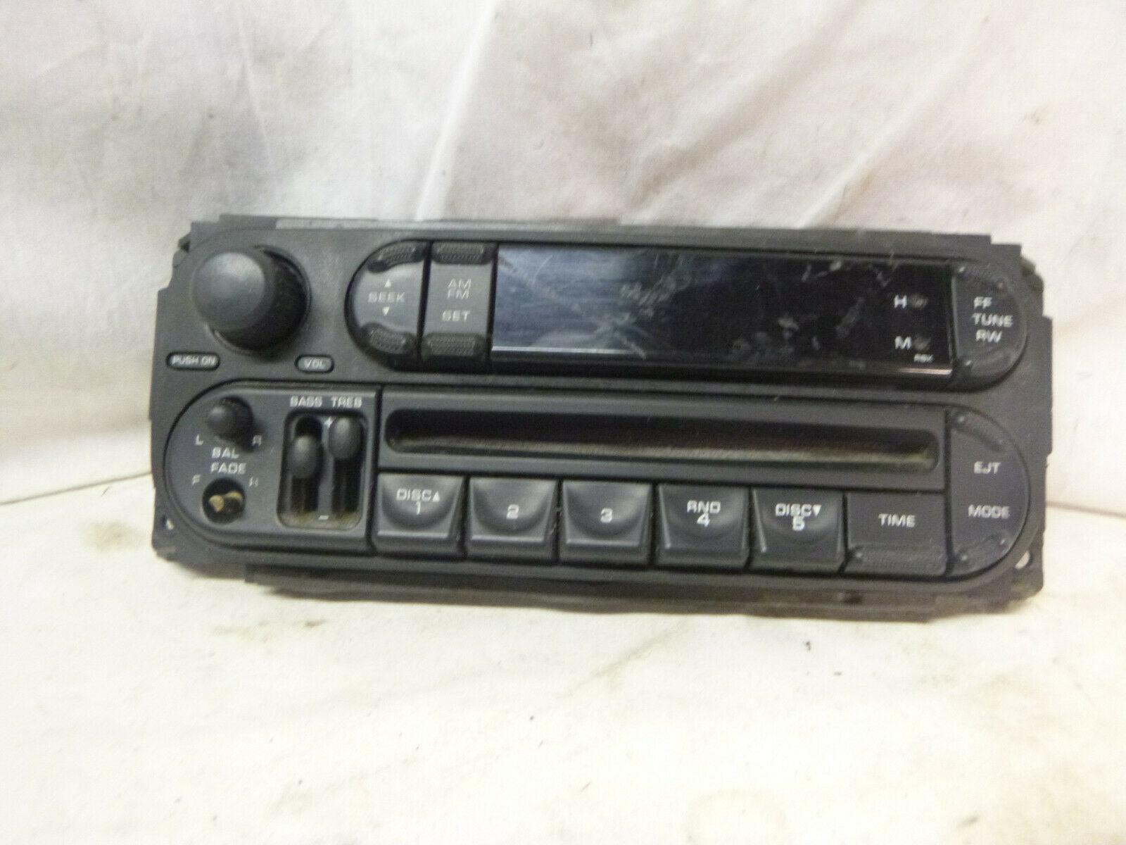 02-07 Dodge Chrysler Jeep Radio Cd Faceplate P05091888AA DEL17