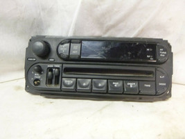 02-07 Dodge Chrysler Jeep Radio Cd Faceplate P05091888AA DEL17 - $17.82