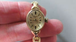 14k gold vintage analog wind up womens Bulova gold watch-Onyx stones-10.... - $379.99