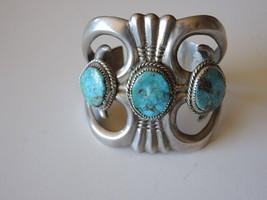 Old Navajo Sandcast Bracelet with Three Turquoise Stones - $641.35
