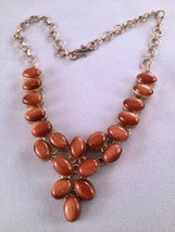 Sterling Silver and Bezel Set Orange Goldstone Cabochon Necklace - $250.00