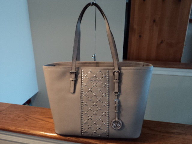 6a3595847915 S l1600. S l1600. Previous. Authentic Michael Kors Jet Set Travel TZ Stud  Tote Large Leather Pearl Grey NWT