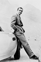 Sean Connery Leaning Against Aston Martin 18x24 Poster - $23.99