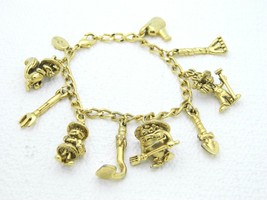 90's Gold Tone Warner Brothers Gardening Character Charm Bracelet - $23.76